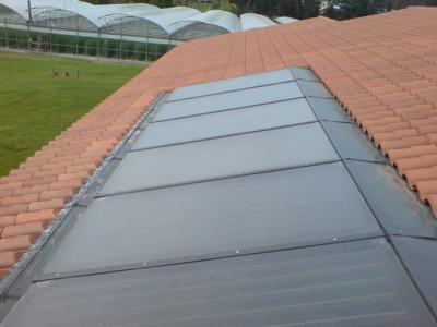 Paneles solares integración en tejado - Producción ACS y Calefacción